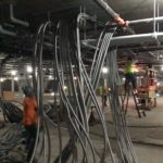 Continuing Racking and Conduit in Garage G1 and G2 – June 2021